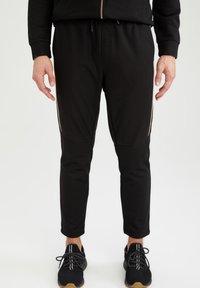 DeFacto Fit - Pantalon de survêtement - black - 0