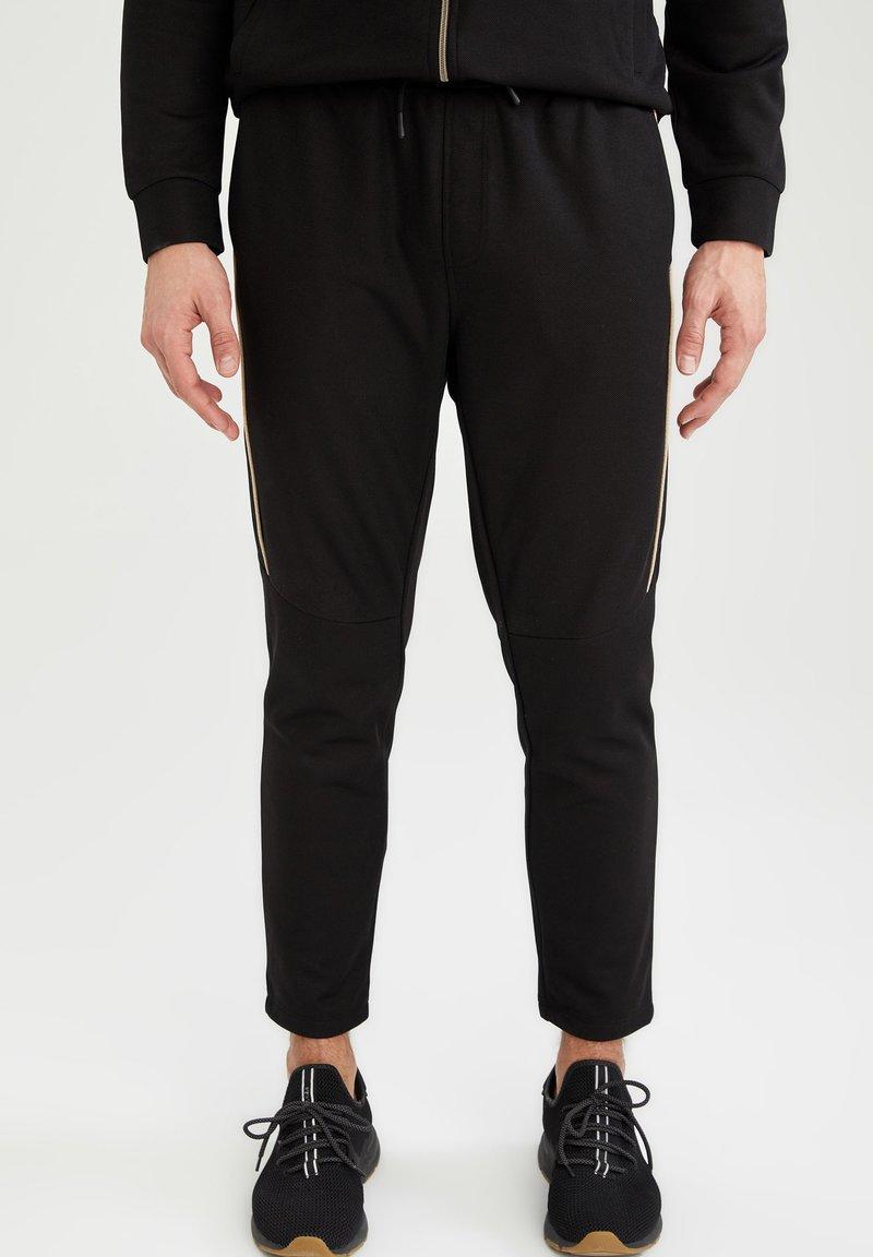 DeFacto Fit - Pantalon de survêtement - black