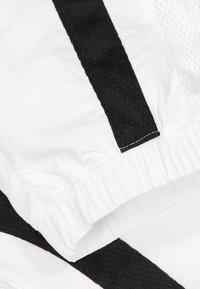 Champion Rochester - ROCHESTER - Tracksuit bottoms - white/black/white - 3