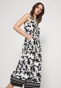 comma - OVERALL 3/4 - Jumpsuit - black/white - 3