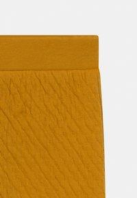 Sense Organics - NALU BABY UNISEX - Trousers - mustard - 2