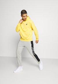 Nike Sportswear - Pantaloni sportivi - grey heather/black/white - 1