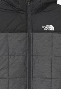 The North Face - REVERSIBLE PERRITO UNISEX - Zimní bunda - medium grey heather - 4