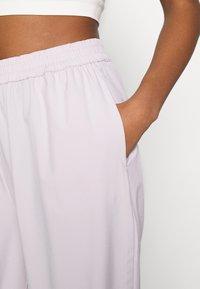 NA-KD - NA-KD X ZALANDO EXCLUSIVE - SPORTY FABRIC PANTS - Tracksuit bottoms - lilac - 3