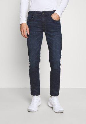 STOCKHOLM - Straight leg jeans - coated navy