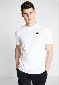 Kappa - FRANKLYN - Basic T-shirt - bright white - 0