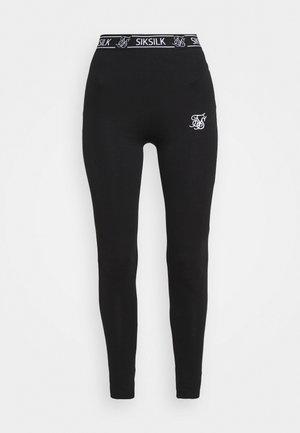 CORE LEGGINGS - Leggings - Trousers - black