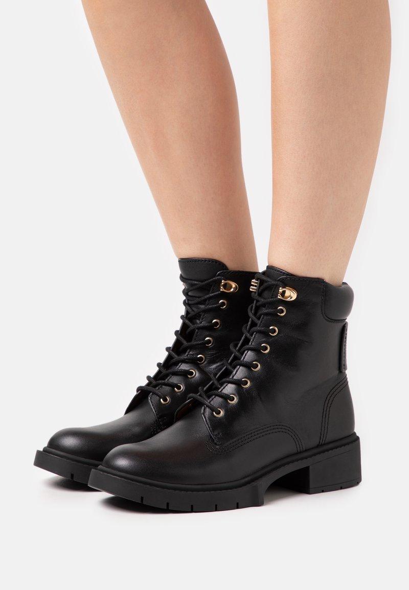 Coach - LORIMER BOOTIE - Lace-up ankle boots - black