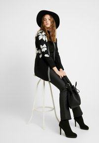 ONLY - ONLEUNICE CARDIGAN - Cardigan - black/cloud dancer - 3