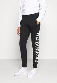 Calvin Klein Jeans - PANT - Tracksuit bottoms - black - 0