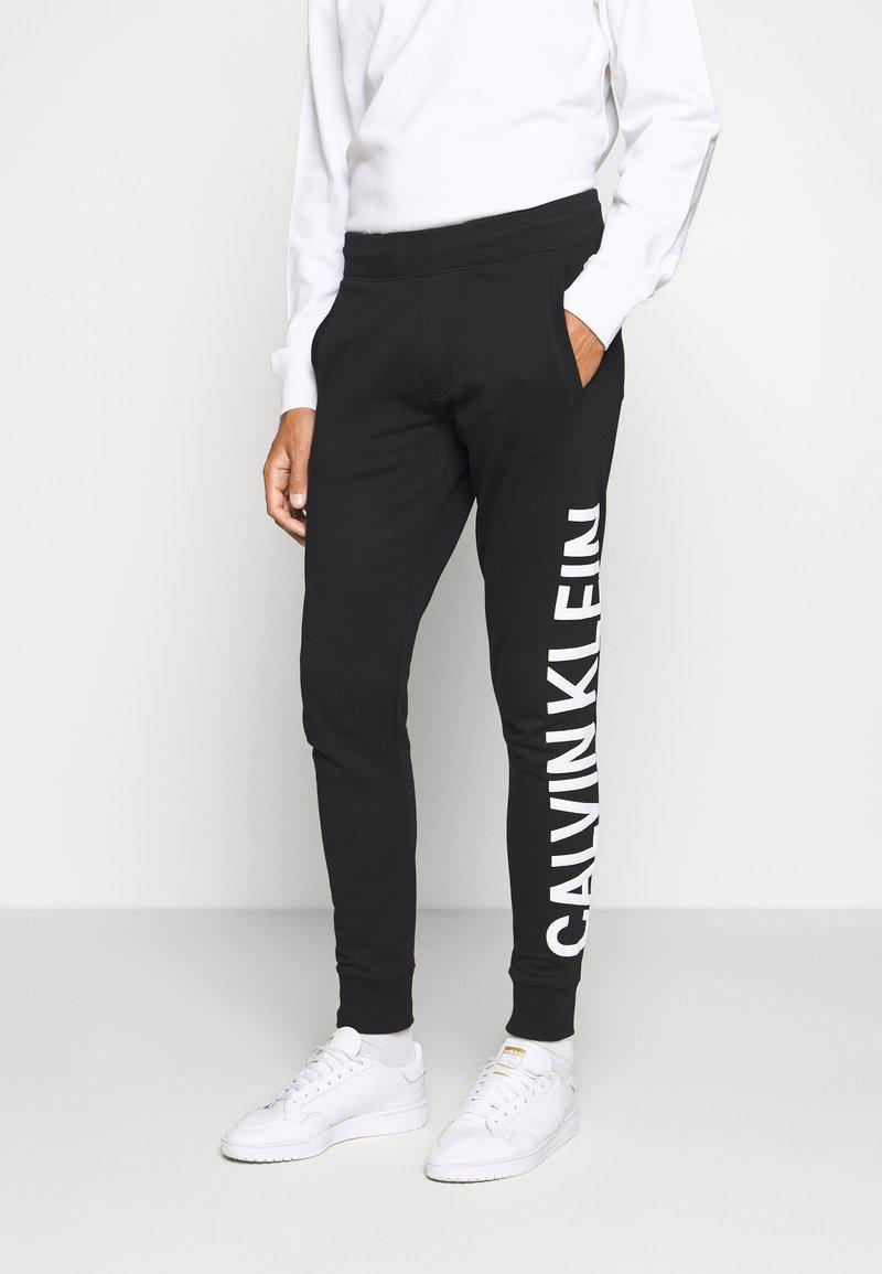 Calvin Klein Jeans - PANT - Tracksuit bottoms - black