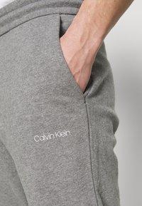 Calvin Klein - SMALL LOGO - Tracksuit bottoms - grey - 4