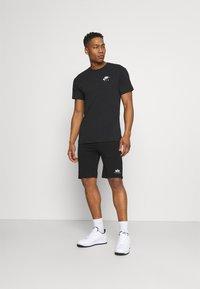 Nike Sportswear - Triko spotiskem - black - 1