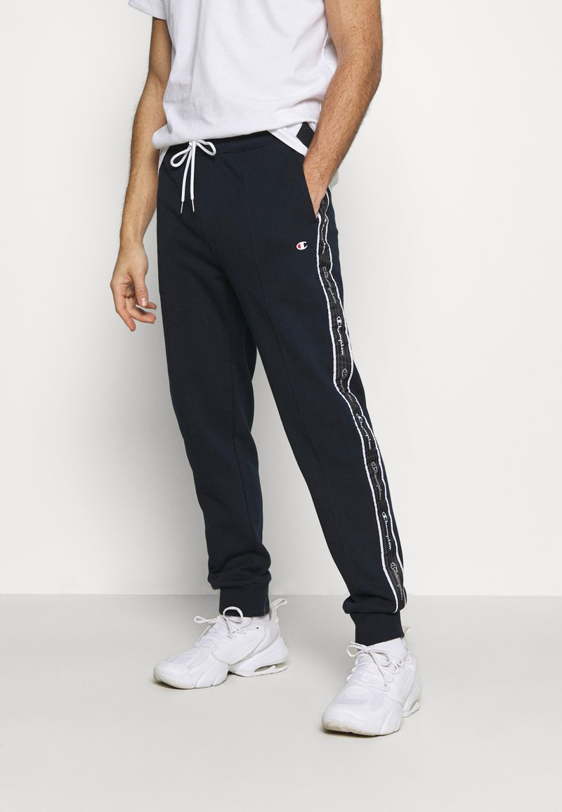 Champion - CUFF PANTS - Tracksuit bottoms - dark blue