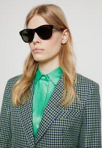 Gucci - Occhiali da sole - black/green - 3
