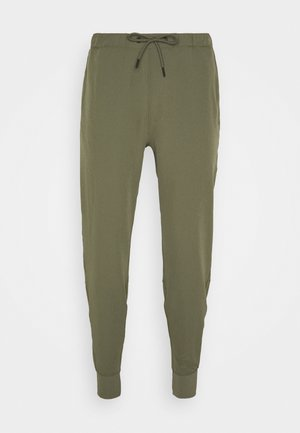 TRAVELER JOGGER - Trousers - olive green