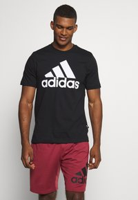 adidas Performance - ESSENTIALS SPORTS SHORT SLEEVE TEE - T-shirt con stampa - black - 0