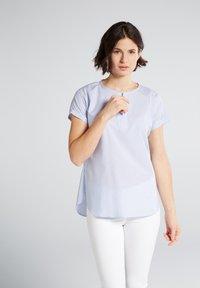 Eterna - MODERN CLASSIC - Blouse - light blue/white - 0