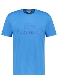 Lacoste - TH8602-00 - T-shirt imprimé - blau - 0