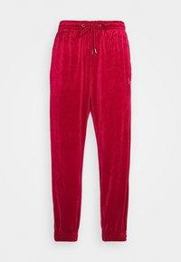 SIGNATURE TRACK PANTS UNISEX - Spodnie treningowe - dark red