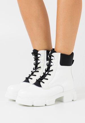 VELAR BOOT - Platform ankle boots - white