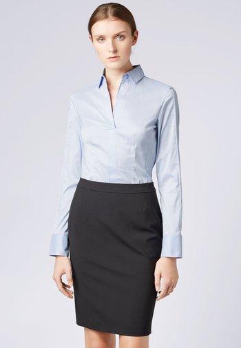 BASHINA - Button-down blouse - light blue