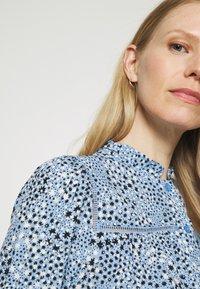 Marks & Spencer London - STAR FRILL PEPLUM - Blouse - blue - 3