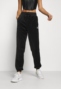 adidas Originals - JOGGER - Tracksuit bottoms - black - 0