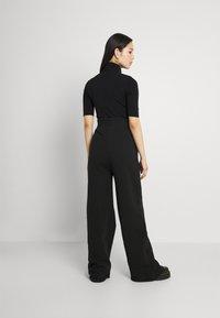KENDALL + KYLIE - K AND K FLARE HIGH RISE - Pantalones deportivos - black - 2