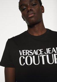 Versace Jeans Couture - LOGO - Print T-shirt - black - 4