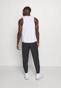 Nike Performance - PANT - Tracksuit bottoms - black/silver - 2