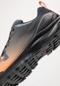 Salomon - VAYA GTX - Hiking shoes - ebony/cantaloupe/black - 5