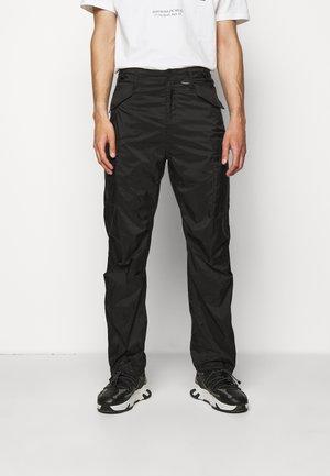 TRANSLUCENT PANTS - Cargo trousers - black
