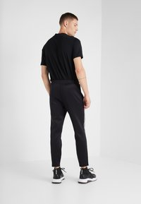 Neil Barrett BLACKBARRETT - LOGO TAPE - Tracksuit bottoms - black/white - 2