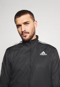 adidas Performance - MARATHON - Sports jacket - black/white - 3