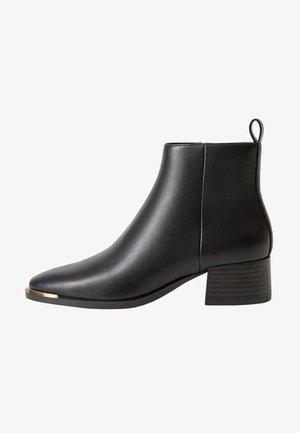 MINUTE - Kotníková obuv - schwarz