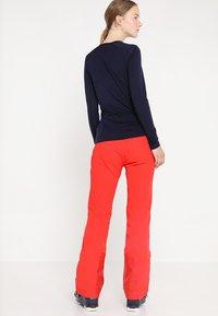 Kjus - WOMEN FORMULA PANTS - Snow pants - fiery red - 2