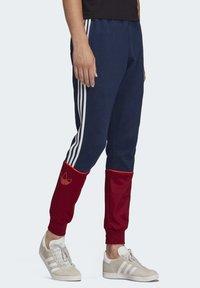 adidas Originals - OUTLINE JOGGERS - Tracksuit bottoms - blue - 3