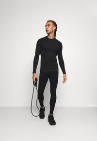 NU-IN - COMPRESSION LONG SLEEVE - Long sleeved top - black - 1