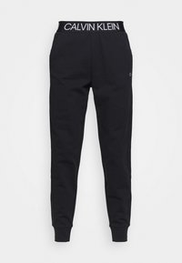 Calvin Klein Performance - Tracksuit bottoms - black - 3