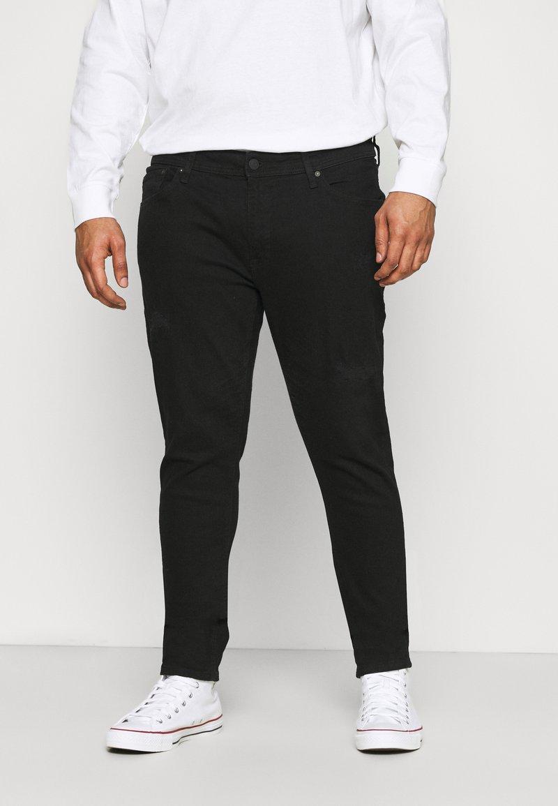 Jack & Jones - JJILIAM JJORIGINAL - Trousers - black denim