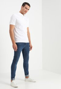 Calvin Klein - REFINED CHEST LOGO - Polo shirt - perfect white - 1