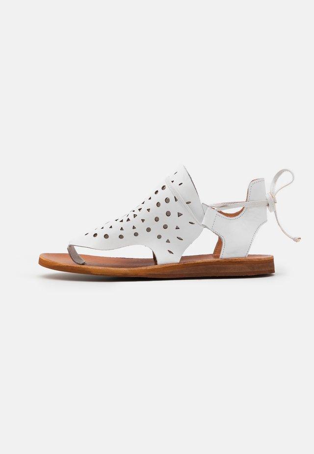 CAROLINA  - T-bar sandals - white