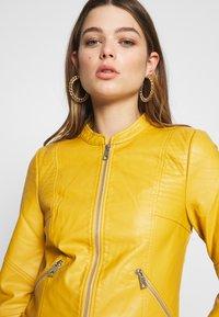 Vero Moda - VMRIAMARTA  - Faux leather jacket - amber gold - 3