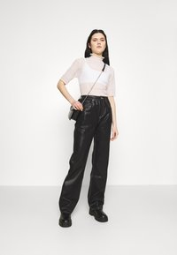 Topshop - COATED RUNWAY - Relaxed fit jeans - black - 1