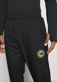 Nike Performance - ESSENTIAL PANT - Tracksuit bottoms - black/particle grey - 6