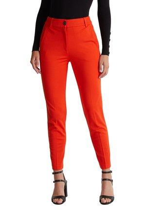 PUNTO - Trousers - rust orange