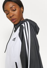 adidas Performance - STRIPES WINDBREAKER - Outdoor jacket - white/black - 4