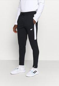 4F - Men's sweatpants - Träningsbyxor - black - 0