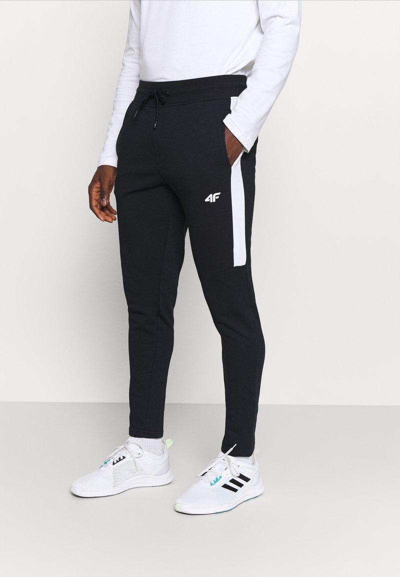 4F - Men's sweatpants - Träningsbyxor - black